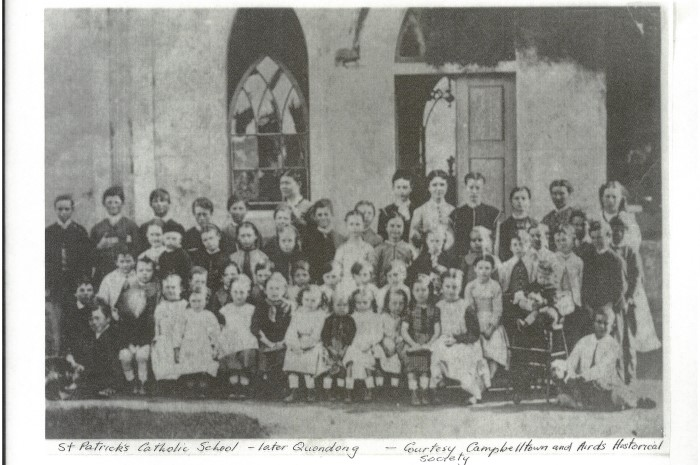 Black and white photo of school students in 1800s