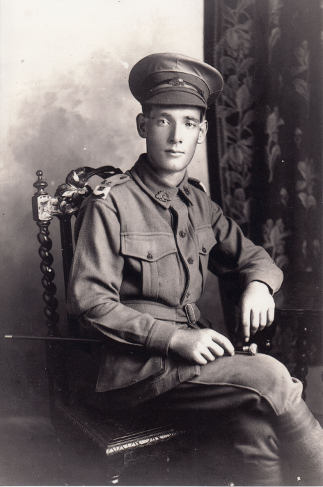 A portrait of a young soldier sitting in a chair