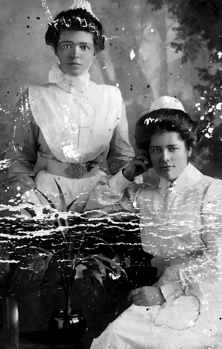 A portrait of two young Nurses in their uniform