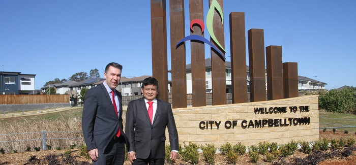 Mayor George Brticevic with Cr Rey Manoto at the Glenfield City Entrance sign.