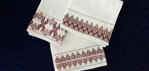 maroon embroidery on white cloth