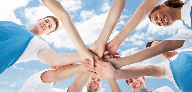 Group of people with hands piled
