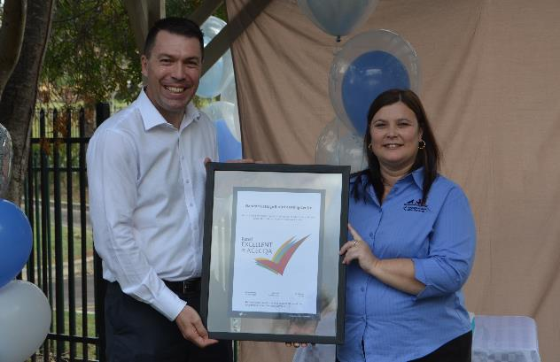 Council's Mayor George Britcevic and Nominated Supervisor of Waratah Cottage Early Learning Centre with Excellent Rating certificate
