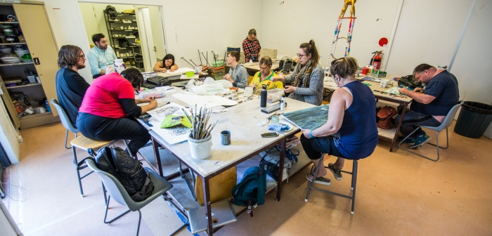 A group of people working in an art studio