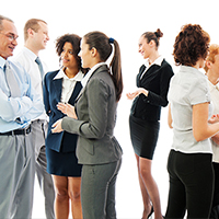 A group of male and female business people talking to each other