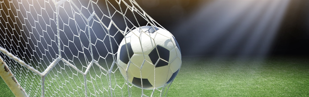 Image of a soccer ball in a goal net