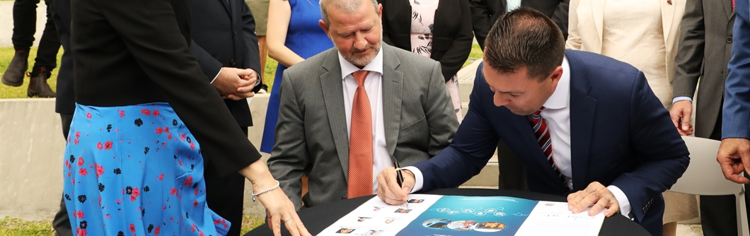 Mayor of Campbelltown, Cr George Brticevic, signing the Western Sydney City Deal