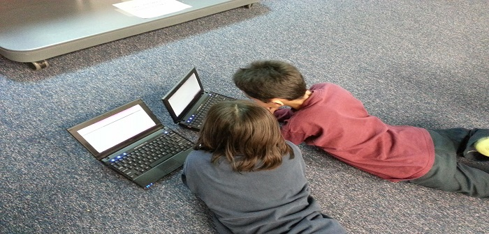 Children coding on a laptop