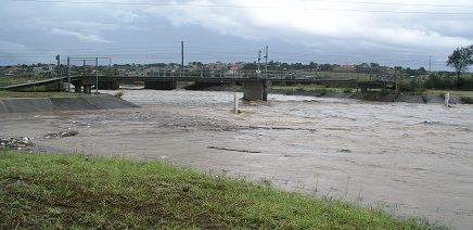 Image of a bridge and a flooded creek in the Campbelltown area